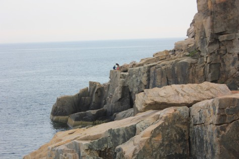 Rock climbing on Otter Cliffs